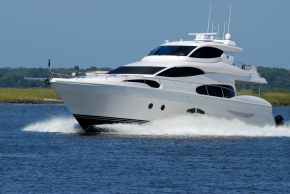 white yacht on running on blue body of water during daytime